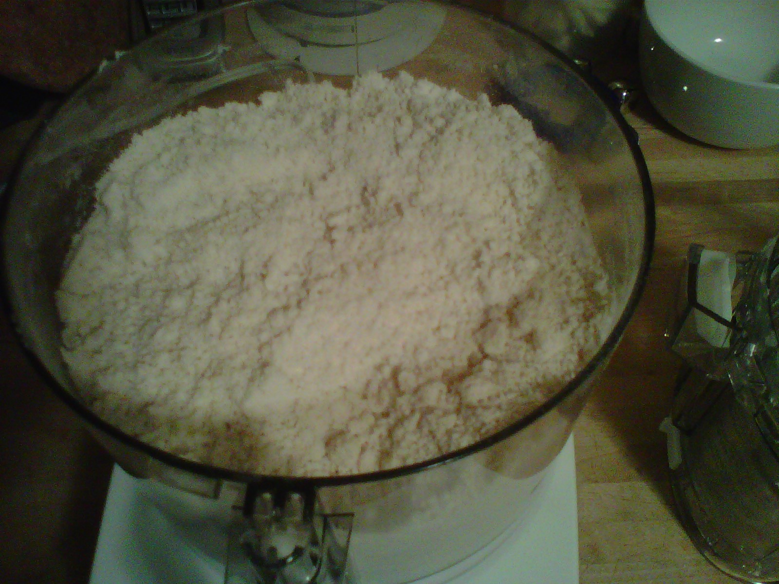 Flour, sugar, salt and butter in food processor, crumbly, like corn meal