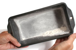 Grease and flour baking pan
